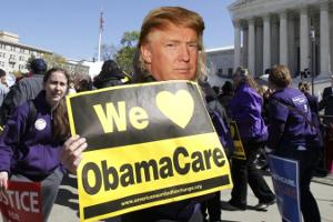 "Donald Trump holding a sign that says, ""We love Obamacare."""