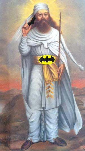 Zarathustra with Batman's belt and Batman's baterang weapon.